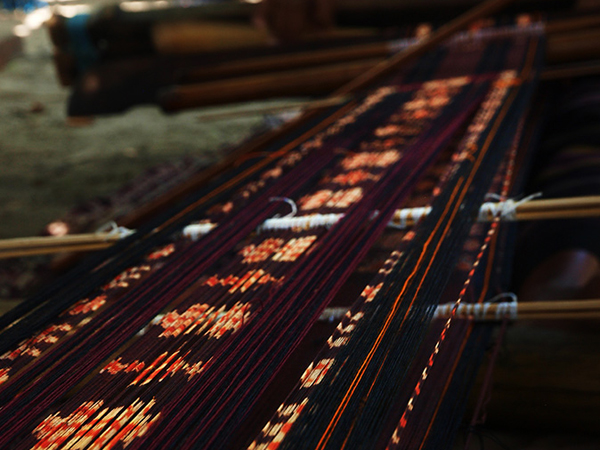 Tenun ikat, weaving process..